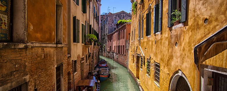 One of the famous canals of Venice, Italy flowing between rows of houses