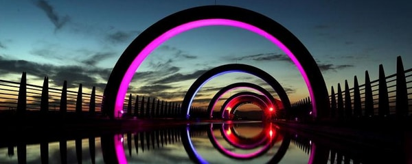A wheel boat lift lit up in colors in Scotland.