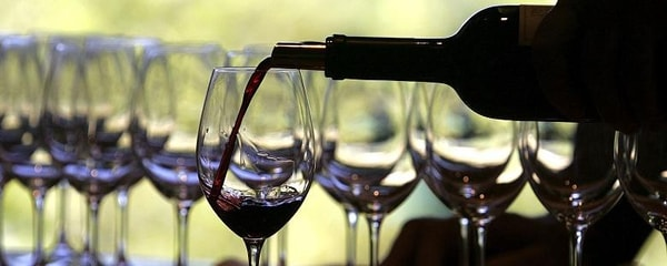 Wine being poured for a tasting in Napa Valley, California.