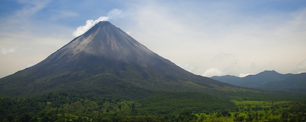 The Arenal Volcano surrounded by greenery in Costa Rica.