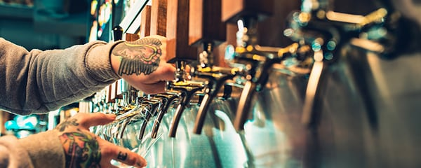 View of hands pouring a delicious beer from a tap in Denver.