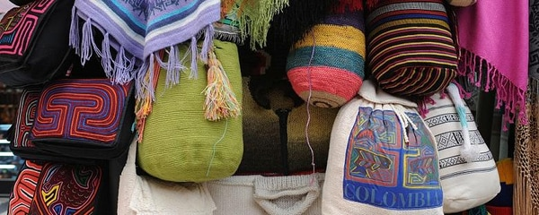 Traditional Mochila bags for sale at a market in Bogota.