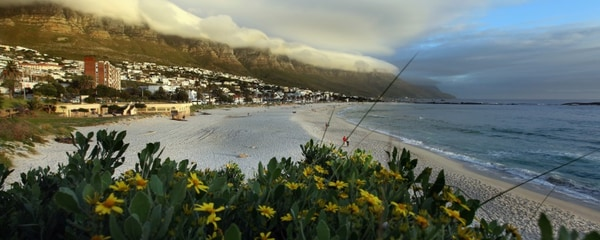The beach at Camps Bay, located at the foot of Table Mountain in Cape Town, South Africa