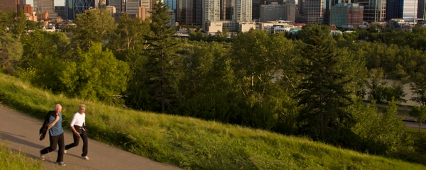 A couple walking on a bike path in Calgary.