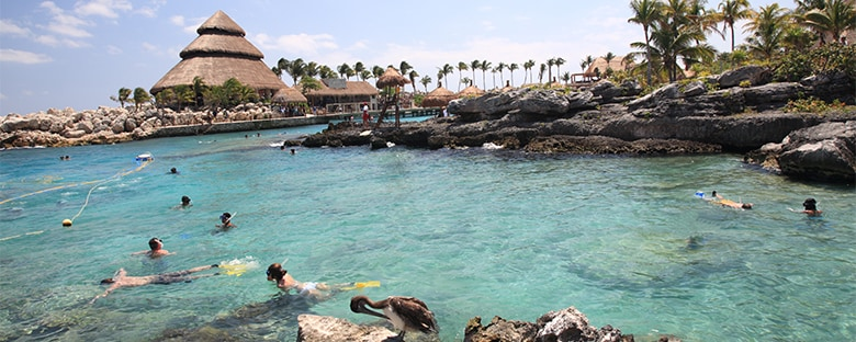 Snorkelers at a natural pool in Xcaret nature park near Cancun.