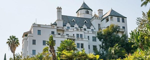 Chateau Marmont in Los Angeles surrounded by lots of greenery.