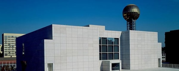 The Knoxville Museum of Art stands in front of the Sunsphere in downtown Knoxville, Tennessee
