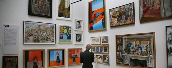 Art-lover examines the collection of an art gallery in the Mayfair neighbourhood of London