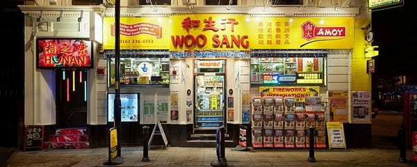 Traditional Asian grocery store at night in Manchester, London's Chinatown