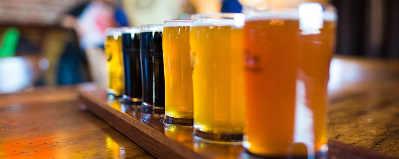 A variety of craft beers to sample at a brewery.