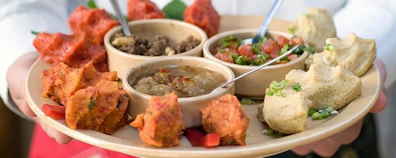 A platter of Middle-Eastern food served by a waiter at a restaurant in Detroit.