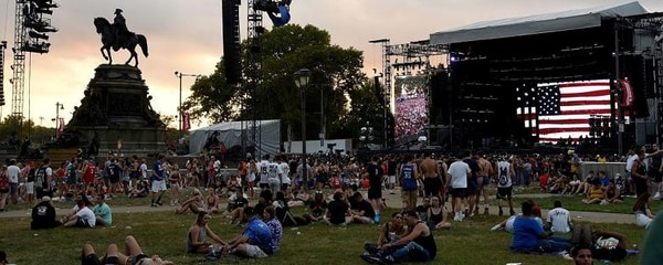 Music fans sit on the lawn at the Made in America music festival in Philadelphia