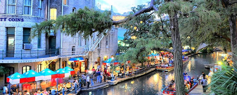 The River walk in San Antonio, Texas filled with travelers.