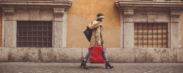 A woman shopping on the streets of Rome, Italy.