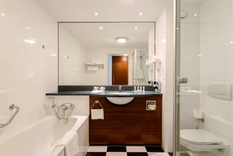 Bathroom with shower and separate bath
