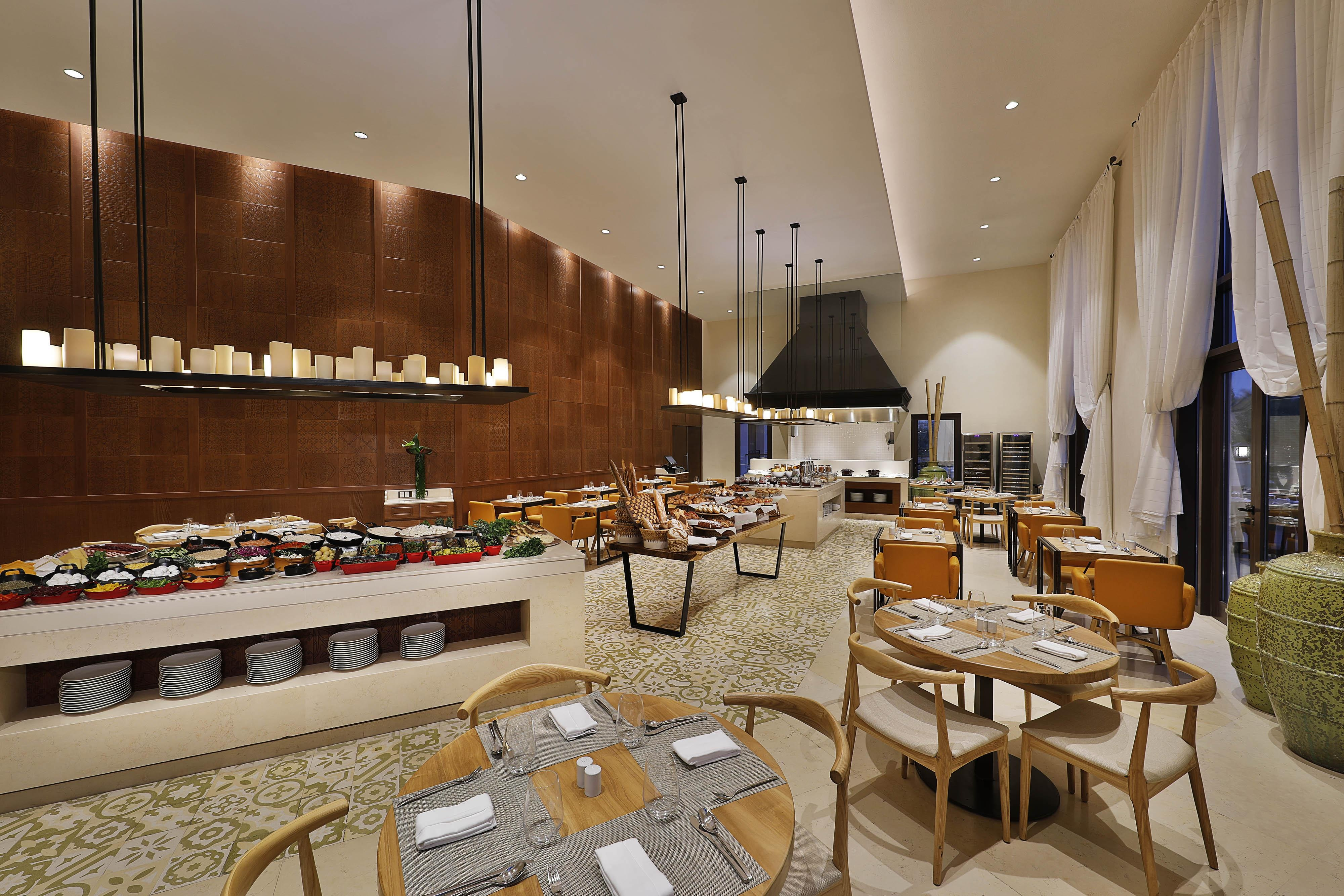 Our casual restaurant serves an exceptional breakfast buffet and hearty cuisines from around the Mediterranean Sea for lunch and dinner.