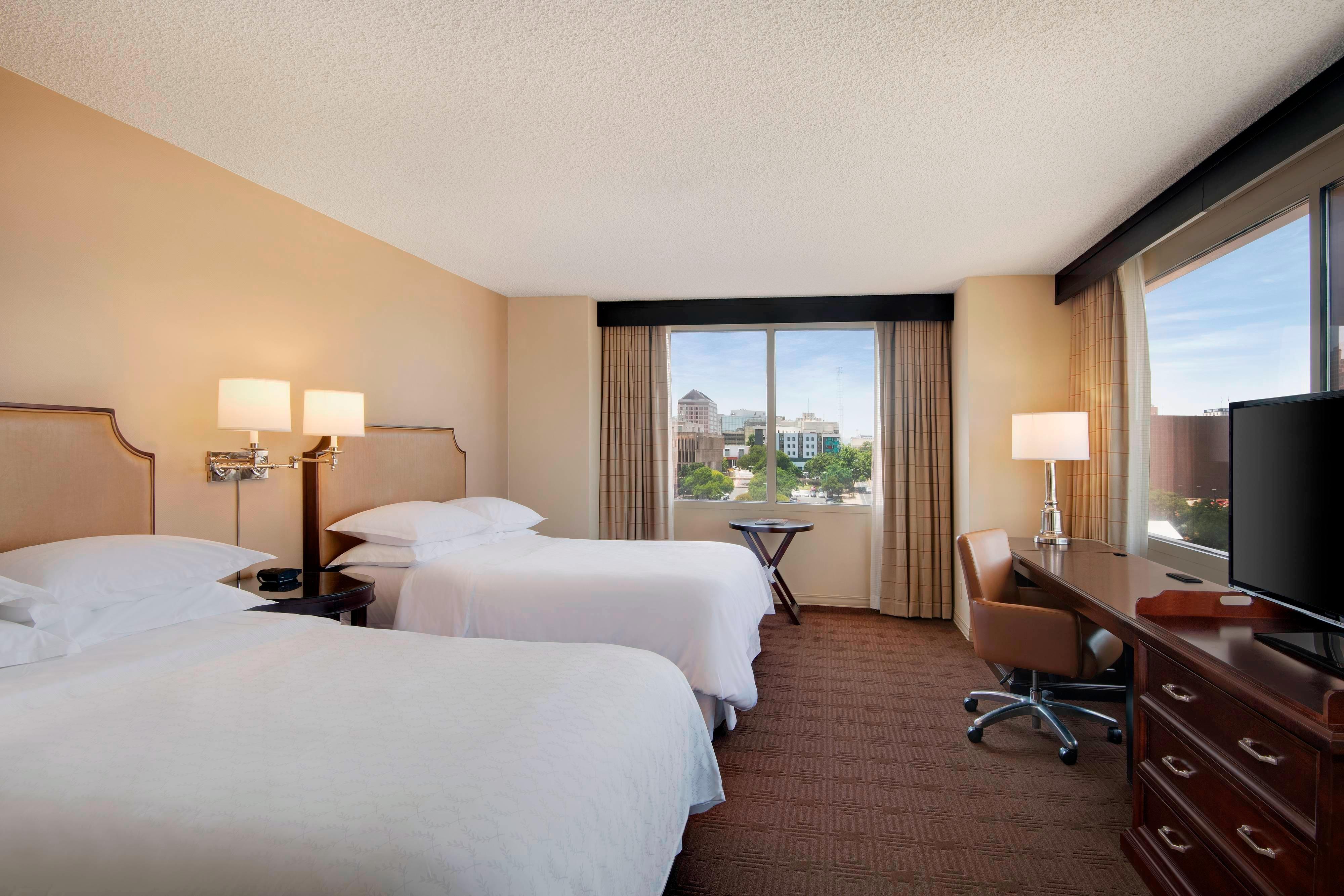 Deluxe Eck-Gästezimmer mit zwei Queensize-Betten