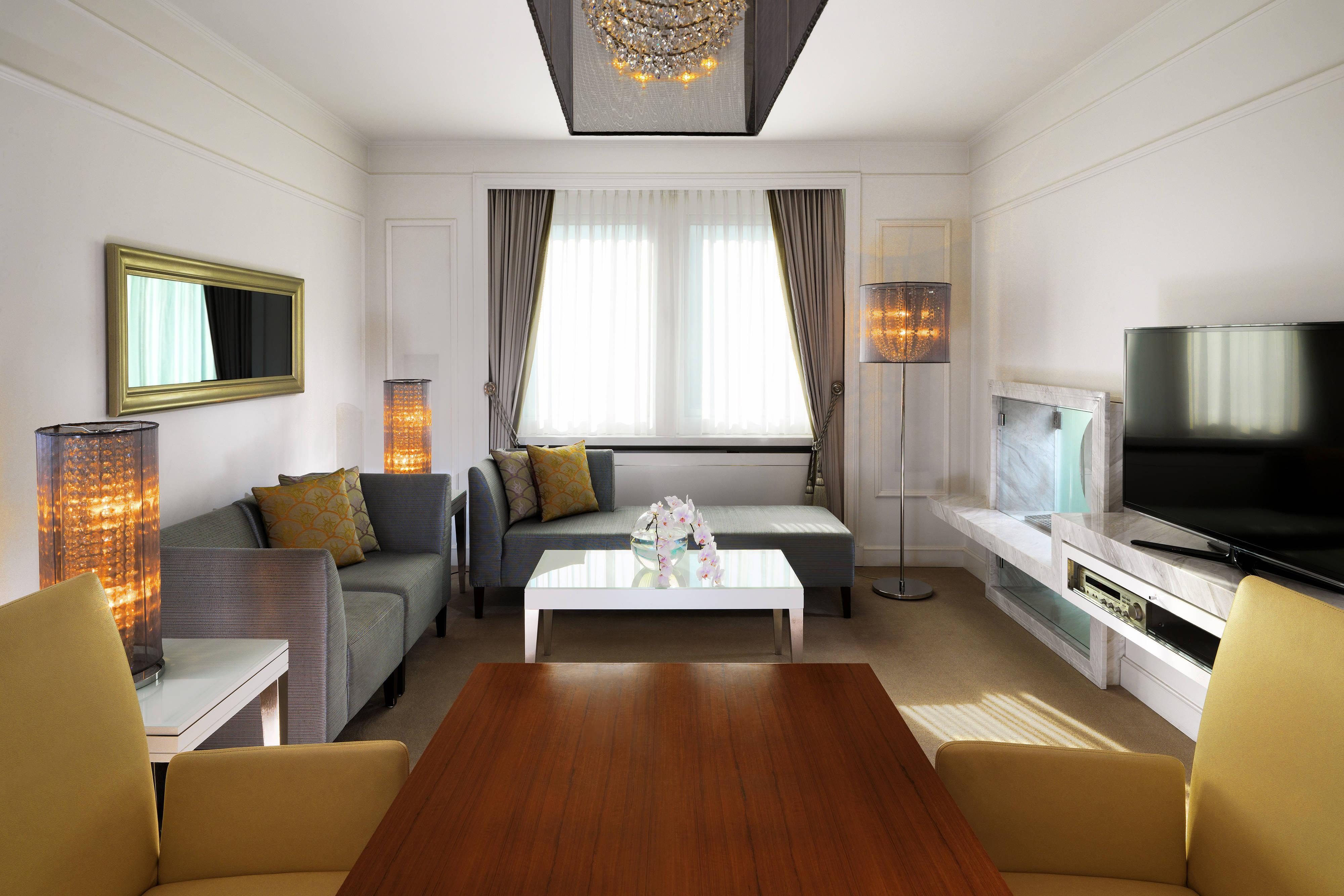 Living area with open fireplace at The Westin Grand hotel Berlin