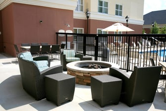Firepit seating area next to the pool