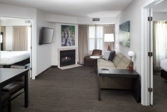 Two bedroom suite living area with fireplace