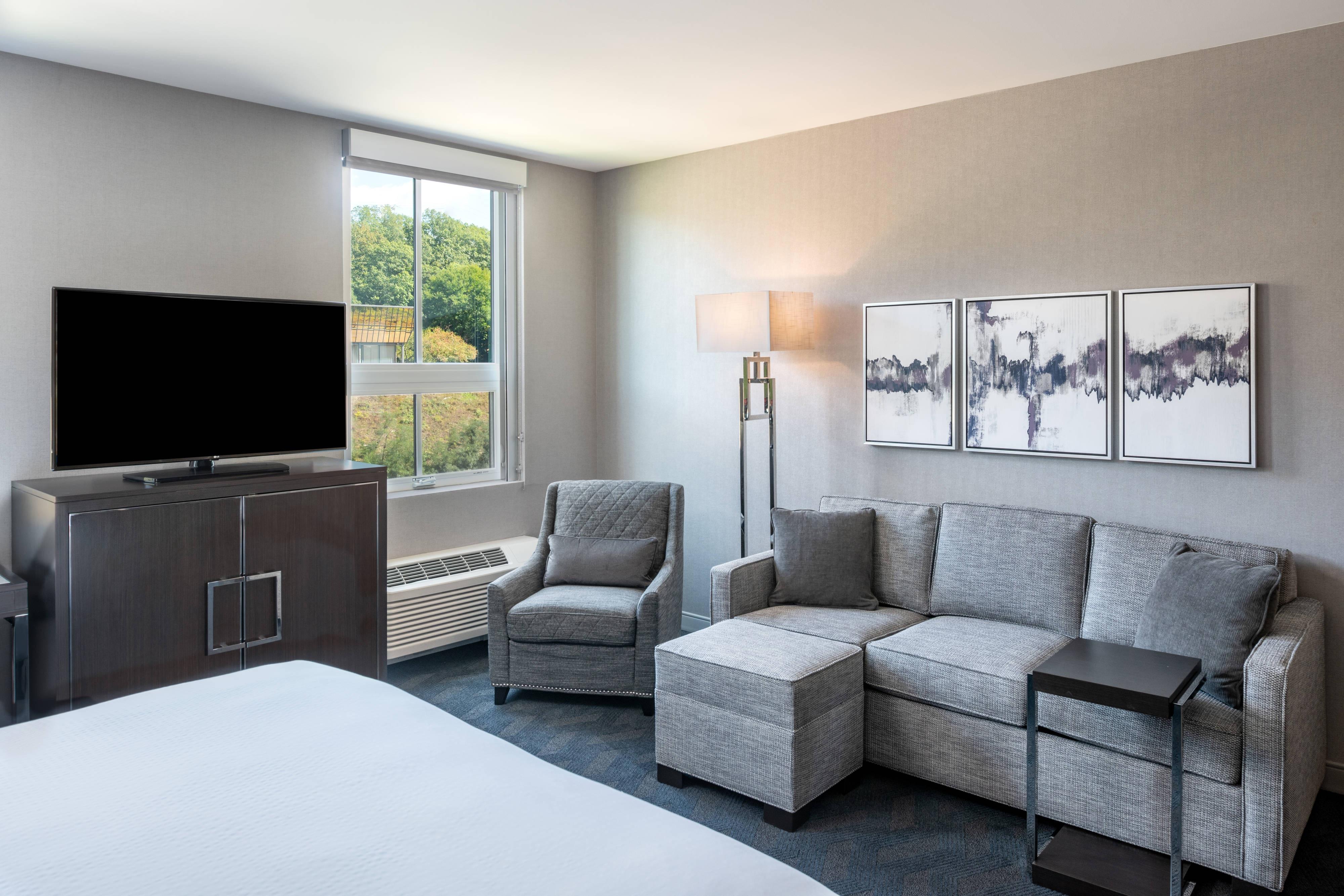 Gästezimmer mit Kingsize-Bett – Wohnbereich