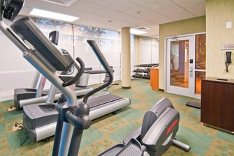 Hotel fitness center in Gonzales