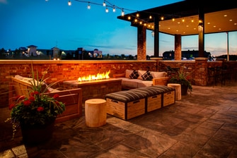 Enjoy the view and cozy seating around our fire pit. The outdoor area with a fire pit is ideal for gathering with friends to relax.