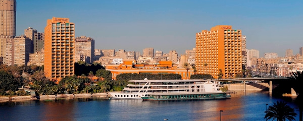 River in foreground with hotel and Cairo skyline in background