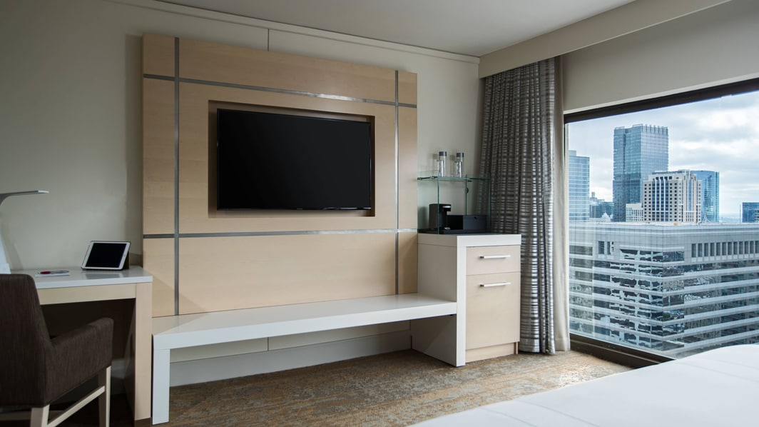 Our renovated guest rooms feature dedicated work space, flat screen TVs and room to unpack and unwind.