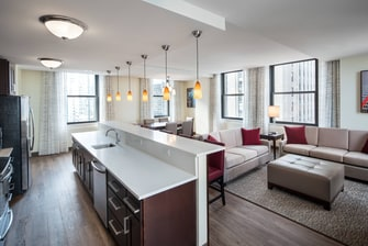 Three-Bedroom Penthouse Living and Kitchen Areas