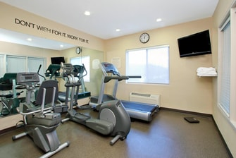 fitness center with towels, treadmill, elliptical, and recumbent bike