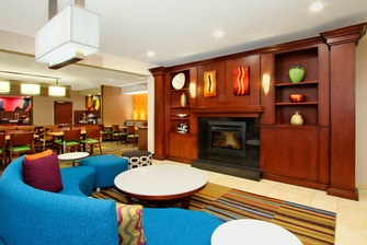 lobby with blue circular couch and fireplace