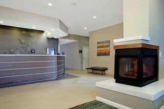 front desk with lobby fireplace