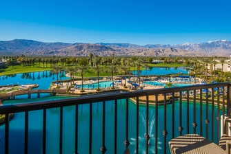Balcony View of Pool, Lake and Mountains