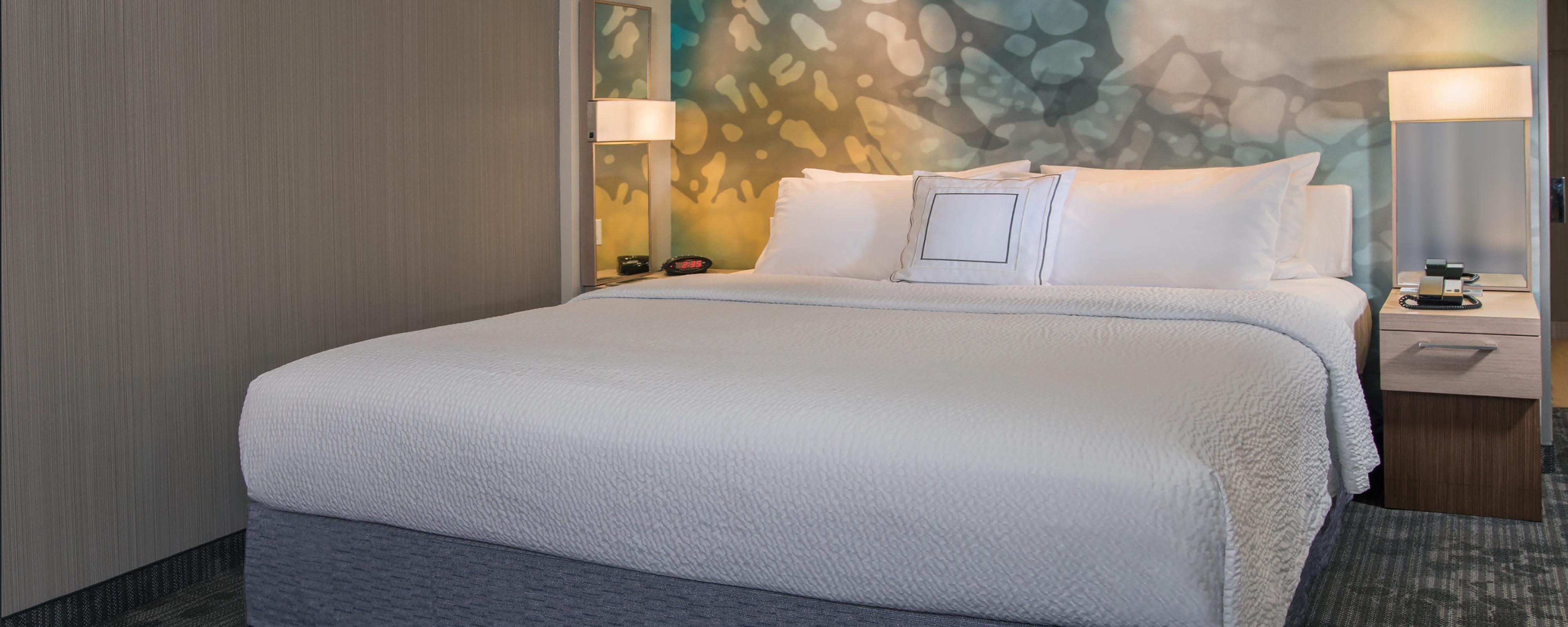 Courtyard Hotel King Guest Room Sleeping Area
