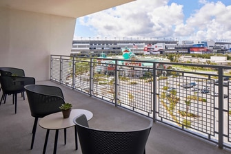 Daytona International Speedway seems so close you could touch it from the balcony of your King Suite.