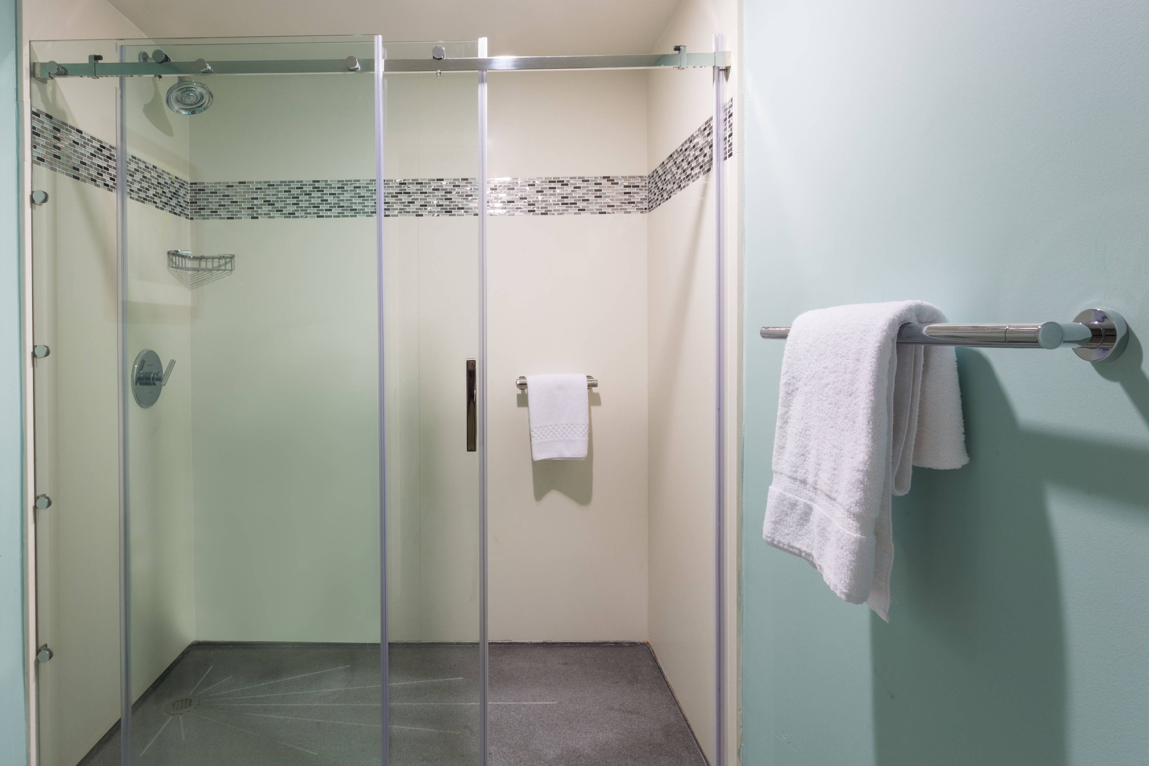 Walk-in glass enclosed shower