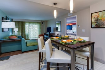 Suite Living and dining area with balcony