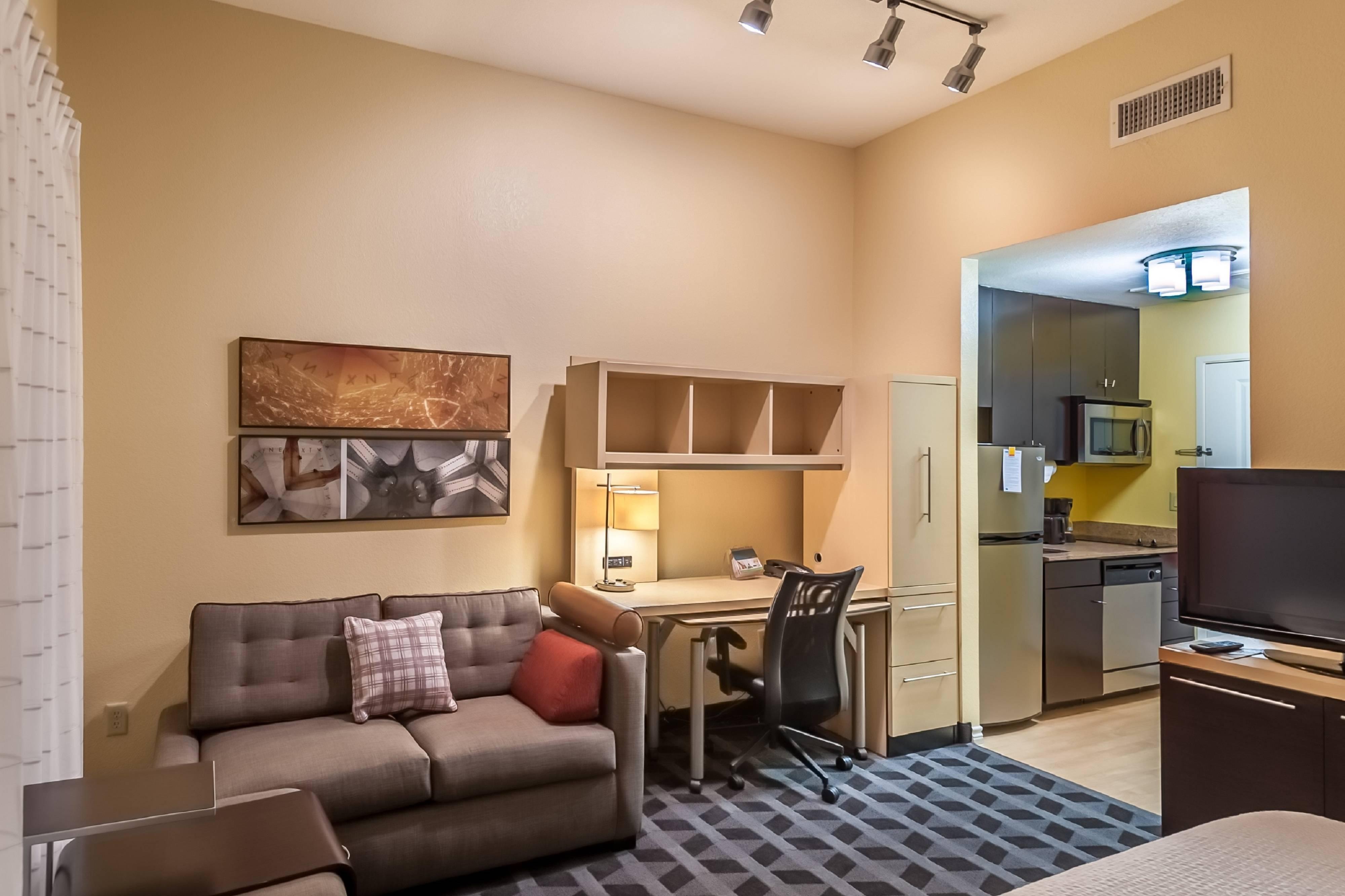Suites Studio - Cocina y sofá desplegable