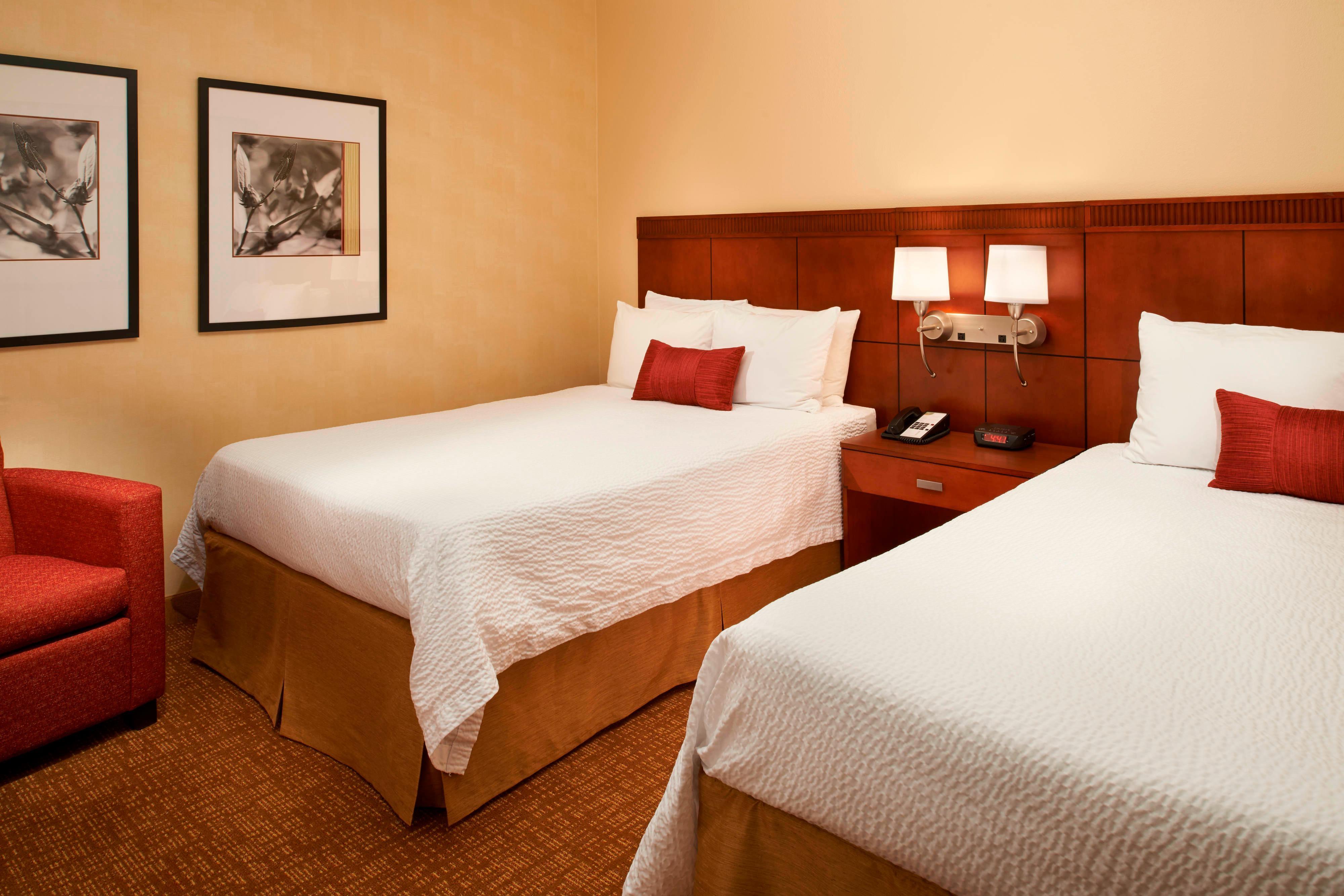 Chambre d'une suite avec deux lits doubles