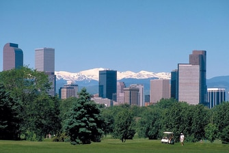 Golfers viewing downtown Denver