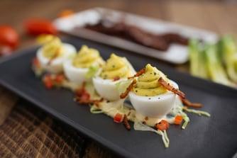 Deveiled eggs