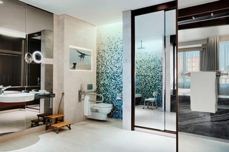 The accessible guest bathrooms are designed for comfort with ample space to move around.
