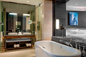 Each Deluxe bathroom enjoys White Tea by Westin™ bathroom amenities, separate tub and large rain shower.