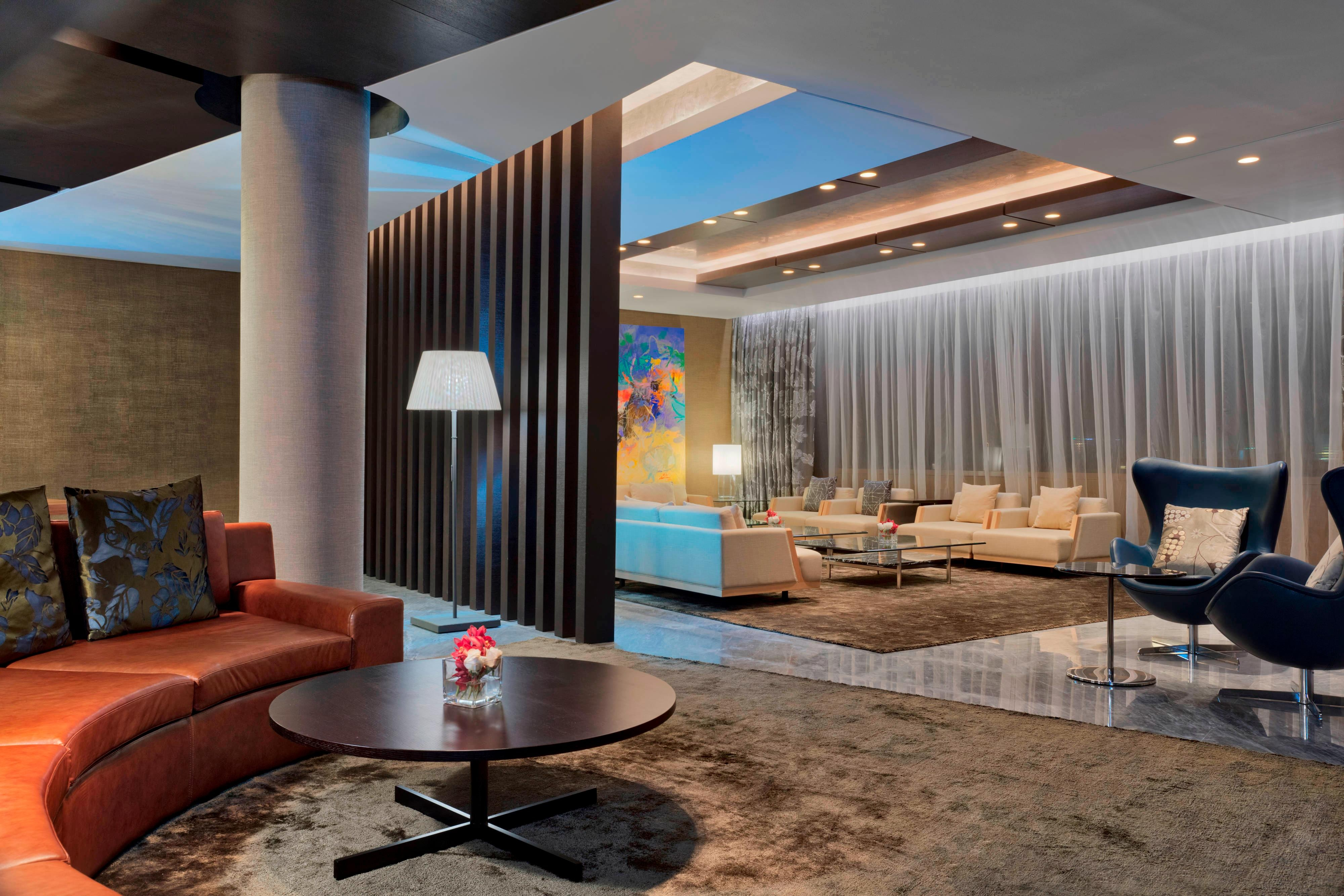 The gracious living room with plush sofa and multiple armchairs invites you to relax and socialize in style. A 55-inch HDTV and Bose entertainment system keeps guests entertained during their stay.