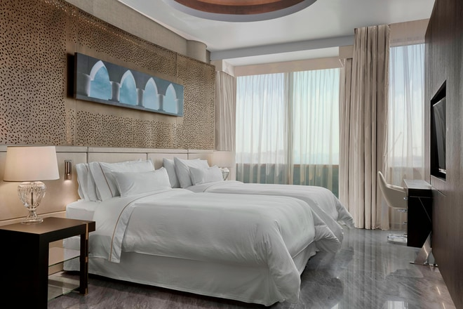 For a restful night's sleep, sink into the Heavenly® Bed, layered with soft white linens, plush duvet, down blanket, and multiple plump pillows. Moreover, this second bedroom features its own full bath with rainforest shower.