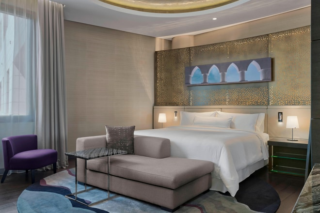 "Every Family Suite master bedroom features a king-size Heavenly® Bed, 48"" LED flat screen TV and vanity unit."