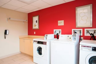 Laundry room at TownePlace Suites Urbandale hotel