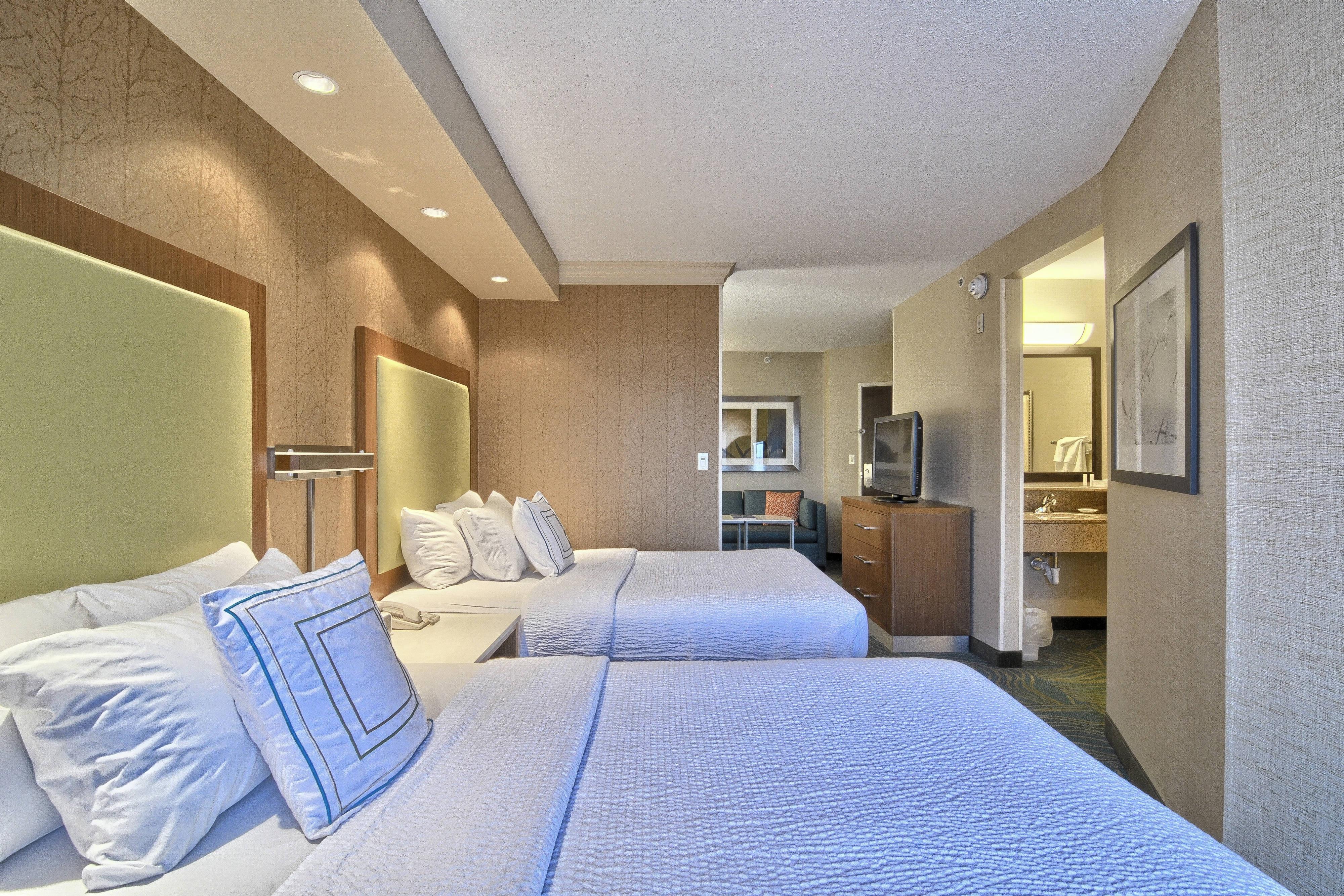 Suite con dos camas dobles - Dormitorio