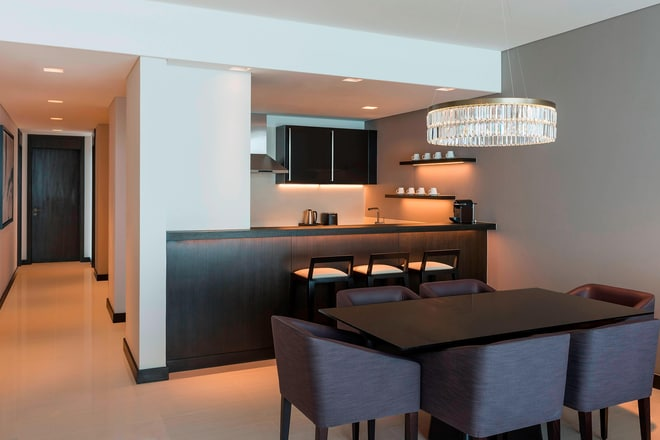 Kitchen and Dining Area in a Three-Bedroom Apartment